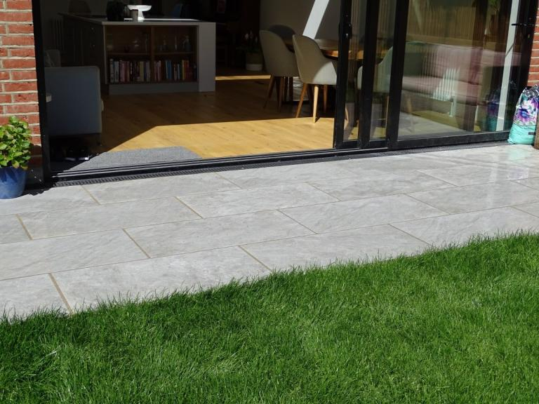 Pavestone Porcelain Patio Paving Domomite Moon Light Grey with Azpects Pointing and Turf Laying